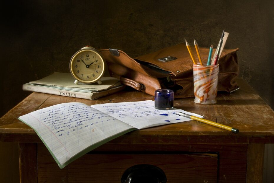 still life of old-fashioned desk and writing materials